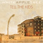 Tell the kids by white apple tree